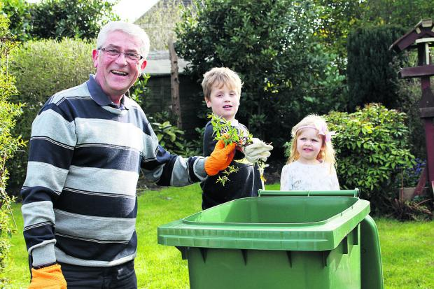 Former railway worker Phil Harman, from central Swindon, with his grandchildren Max, six and Zoe, three with his green waste bin The first collection round of the new optional, paid-for green waste service takes place this week