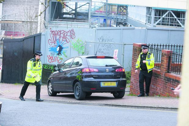 Caught in the act – police pull over a motorist for flouting the one-way system in Cross Street and Prospect Hill