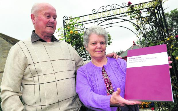 Stan and Margaret Godwin with the Hillsborough report