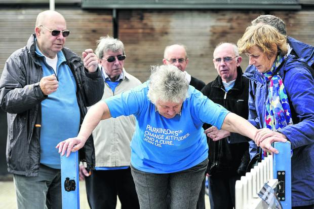 Members of the Swindon branch of Parkinson's UK in Wharf Green with mayor Nick Martin