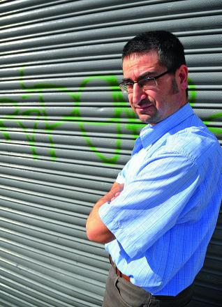 Husnu Cetin, manager of the Trident Fish bar in Victoria Road, is the latest victim of the spate of town centre graffiti as police appeal for residents to identify the tags