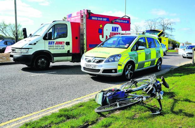 The man's bicycle lies at the scene of the incident near Barnfield