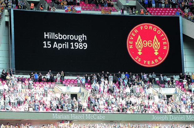 A tribute to those who lost their lives in the Hillsborough Disaster is seen on the giant screen at Anfield
