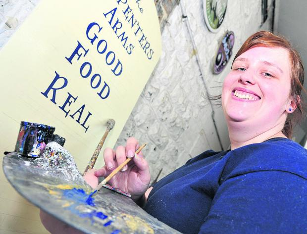 Competition winner Sarah Bromley, who is  Arkell's first female signwriter