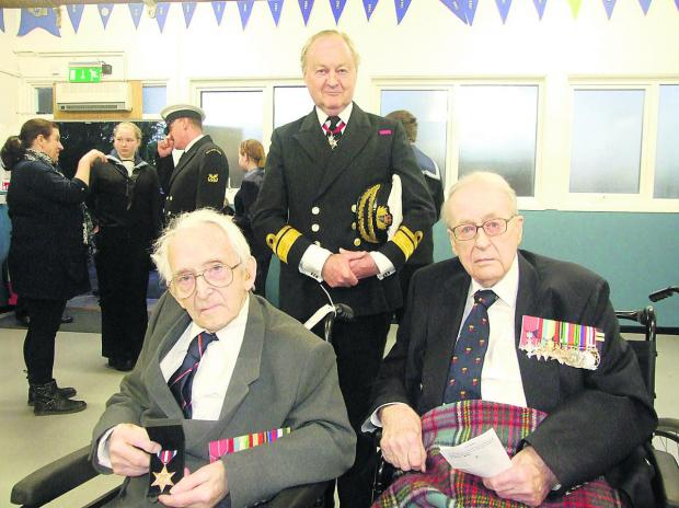 Front left, Cyril Bartlett, the founder of the Swindon Sea Cadets, who has been presented with the Arctic Star, with Rear Admiral Wilkinson behind and Richard Jagger, right