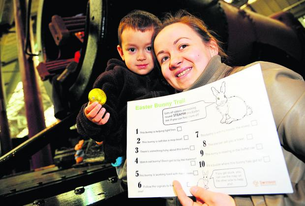 Kevin and Kasia Polewka Mendes, right, locate chocolate rewards at  the Easter bunny Trail at the Steam Museum