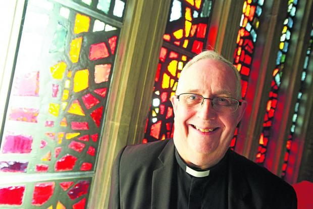 Rev Canon John Cunningham is promoting the true meaning of Easter at Holy Rood Catholic Church