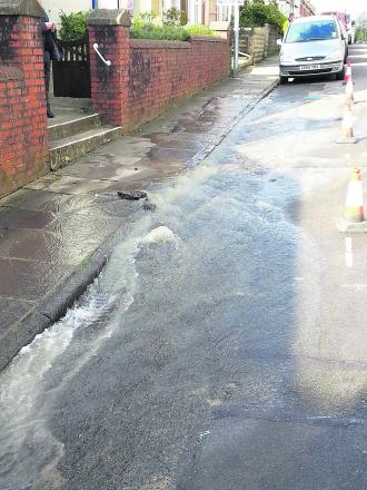 A burst water main flooded Dixon Street on Friday