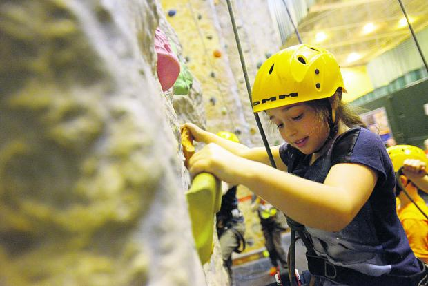 Isabel tackles the climbing wall