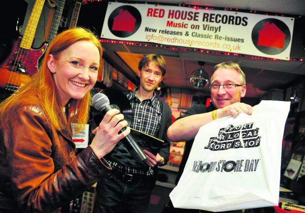 Singer Louise Latham, Paul Holmes and Alan Holmes at John Holmes music store