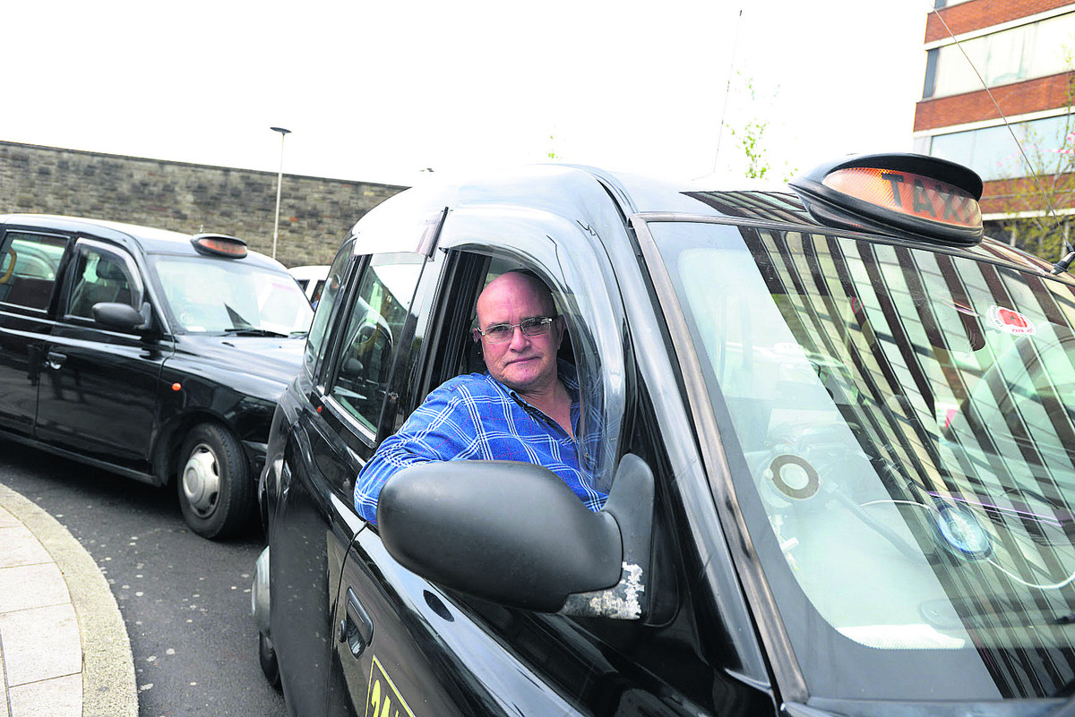 Taxi driver Dave Mackie outside Swindon Railway Station