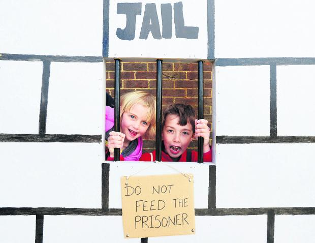 Daisy and Harrison on the jail photo booth at the Restore fun day