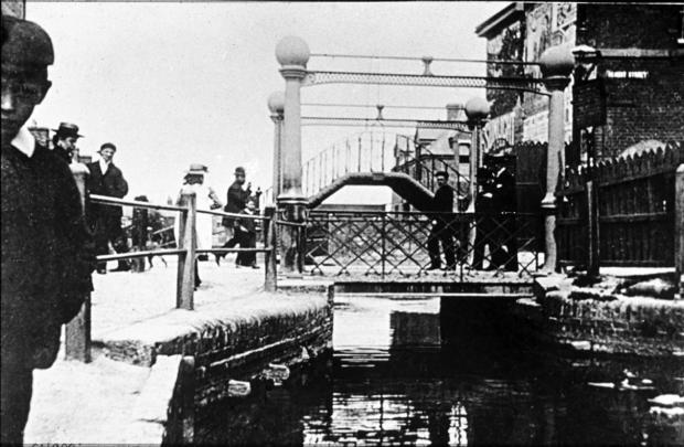 Swindon Advertiser: Three Golden Lion Bridges existed on the spot where Bridge Street today meets Canal Walk. The first, a wooden one erected in 1803, was replaced in the late 19th Century by an iron lift-bridge and supplemented with an elevated walk bridge
