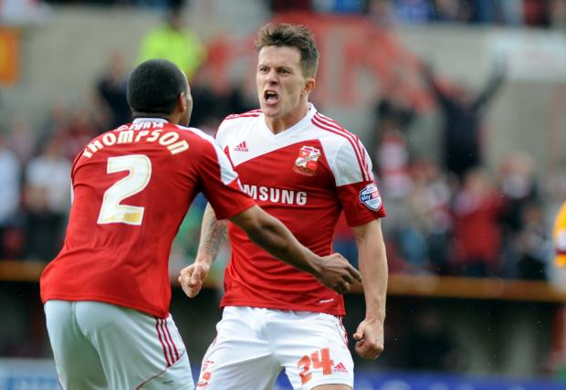 Swindon Town's Lee Cox celebrates his winning goal against Bradford City with Nathan Thompson