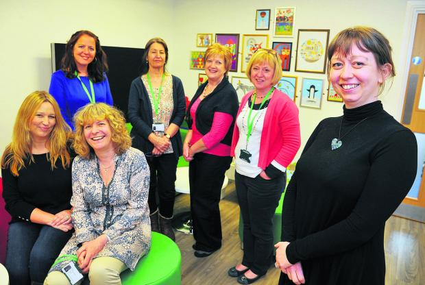 At the opening of the new NSPCC service centre in Old Town are, from left, Caroline Morgan, Carla Jacques, Jeannette Chipping, Irene Davis, Geraldine O'Driscoll, Donna Oakes and Anouska Inns