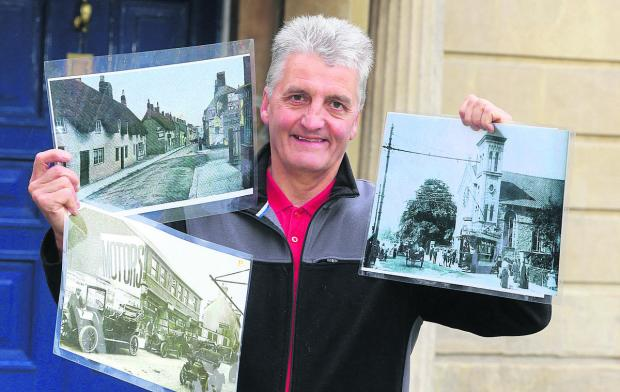 Andy Binks from the Swindon Society holding photographs of old Swindon which are in an exhibition