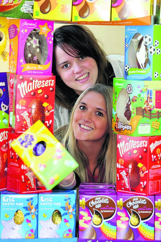 Swindon Advertiser: Amy Francombe, top, with Nichola Fisher from Reed consultancy pictured with some Easter eggs donated in aid of Prospect Hospice