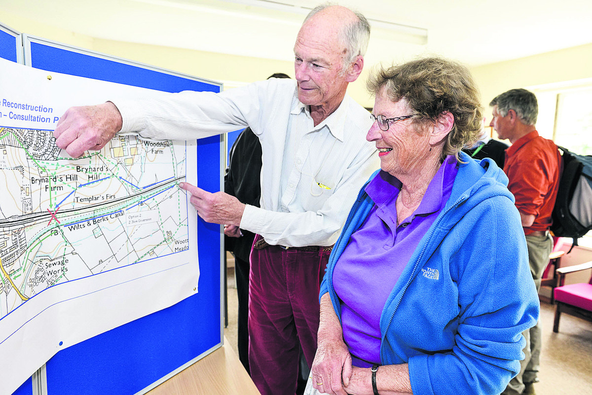 Richard and Judy Gosnell study plans at a public exhibition by Network Rail on the proposed changes to Templars Farm Bridge as part of the new electric line
