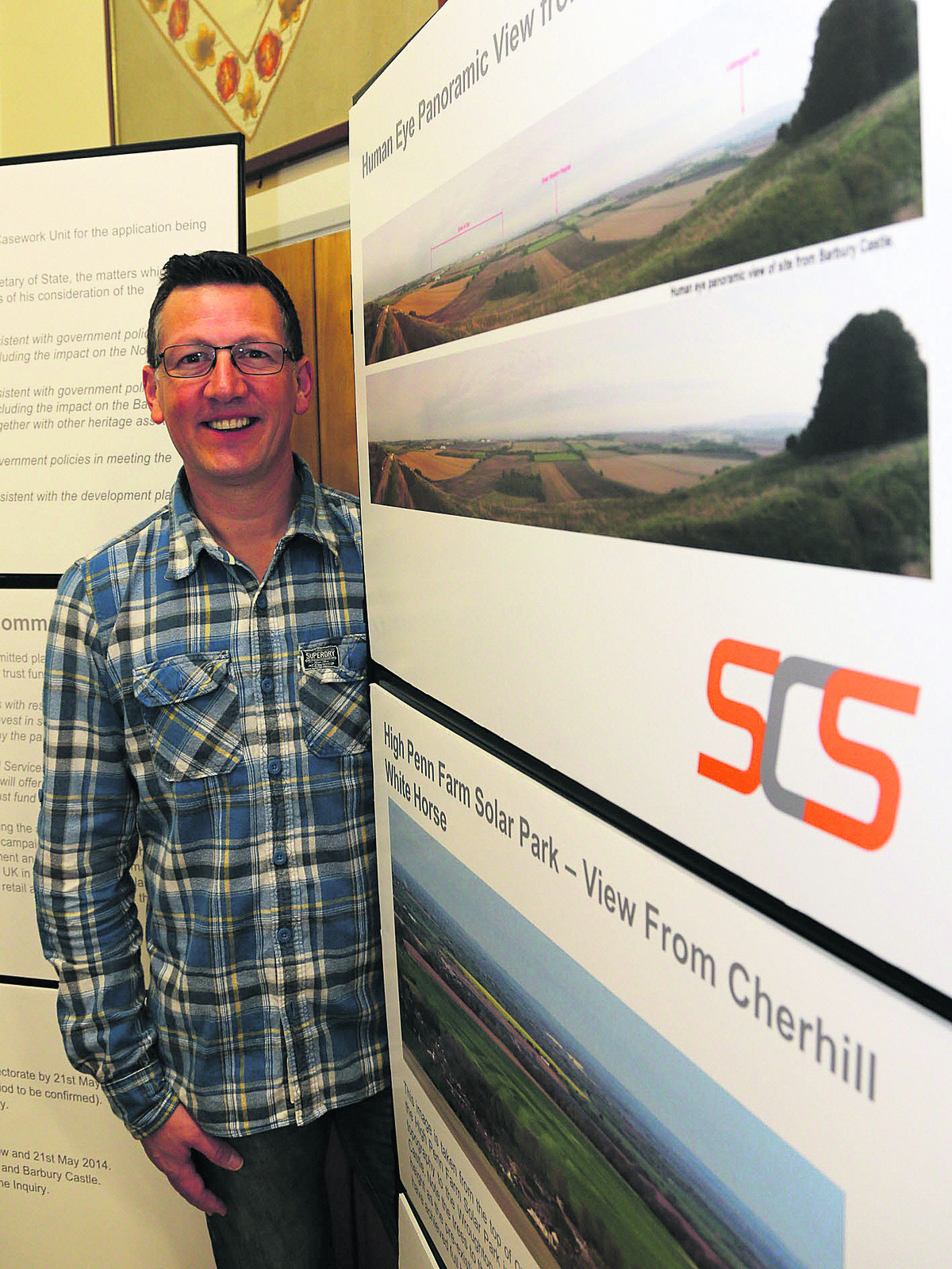 James Owen, commercial director for SCS in Swindon, unveils plans for the Wroughton airfield solar farm to residents