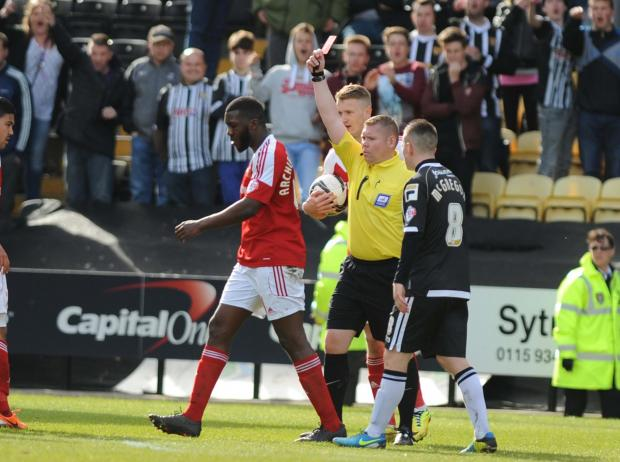 Swindon Advertiser: Troy Archibald-Henville is given his marching orders at Notts County. Picture: Dave Evans