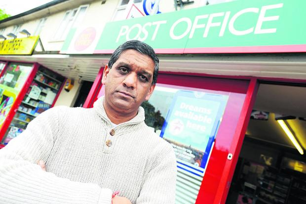 Atul Patel outside Moredon Post Office which was robbed last week. Picture: THOMAS KELSEY