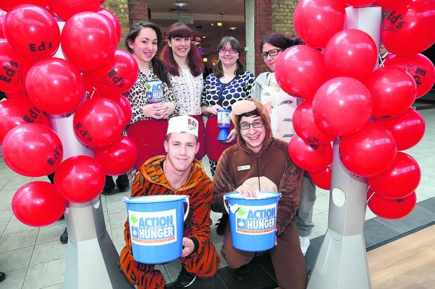 The Ed's Diner staff dressed in onesies for Action Hunger, back row, from left, Beth Cooper, Clare Jefferies, Zoe Stacey and Kaya Cowan, and front, Matthew MacDonald and Daniel Oliver