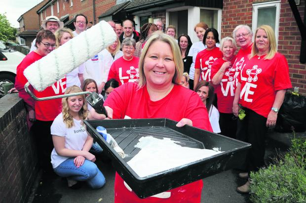 Front, Corrina Rose, from Bromford, who organised the                            painting and decorating charity  event at a supported housing scheme in Old Walcot with volunteers  Nationwide, Bromford and Love Swindon