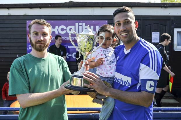 Adver sport writer Tom Bassam presents the trophy to Ajay Sahota
