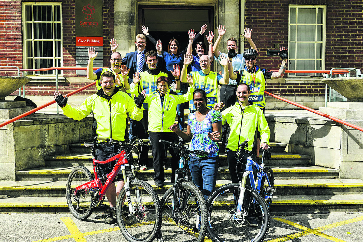 Ready to pedal are Simon Oxlade, Vany Mohanraj, Mark Williams, Deb Tremblin, Craig Scott, Steve Goulding, Rob Norman, Will Melrose, Ian Bickerton, head of Swindon Council's leisure, libraries and culture, Joanne Downing, Brit