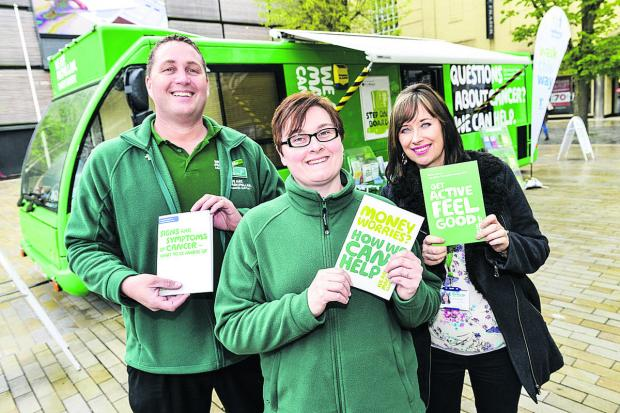 From left, mobile facilities officer Phil Warner and cancer information support specialists Michelle Smith  and Niki McCloud with the Macmillan Support Bus in Swindon town centre