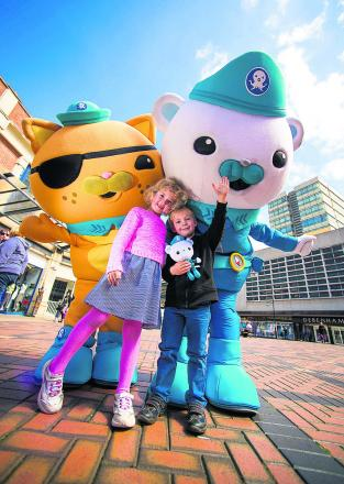 Sam, four, and Jessica, six meet Captain Barnacles and Kwazii, from the Octonauts at the Parade in Swindon