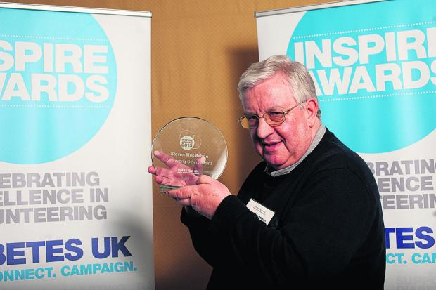 Volunteer Stephen MacMahon with the Inspire Award he received from Diabetes UK in March