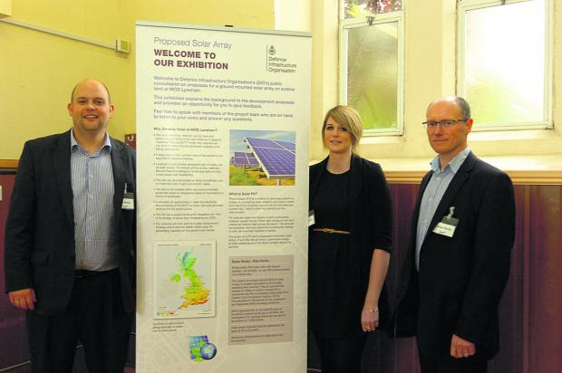 Presenting details of the plans for 160,000 solar panels at MoD Lyneham are, left to right, Neil Martyn, principal consultant, Sarah Phipps, assistant consultant and Angus Martin, technical director from AMEC