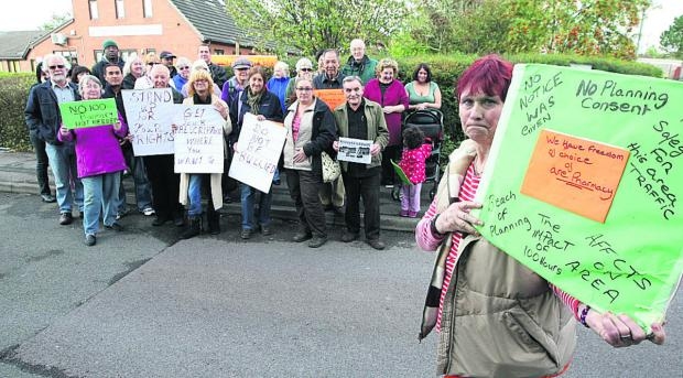 Georgina Stratford, front right, joins other placard-waving residents in Gorse Hill in protesting against the pharmacy at the Hawthorns medical centre