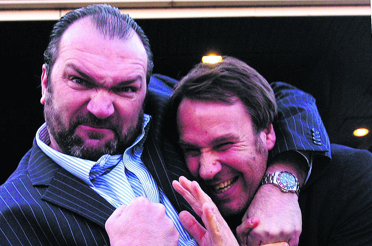 Neil Ruddock grapples with fellow footballer Paul Merson at a previous sporting dinner in Swindon