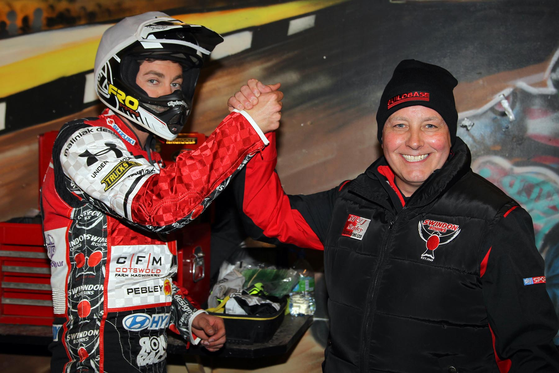 Troy Batchelor and Alun Rossiter celebrate Swindon Robins' 49-41 victory at Coventry Bees last night (picture courtesy of Jeff Davies)