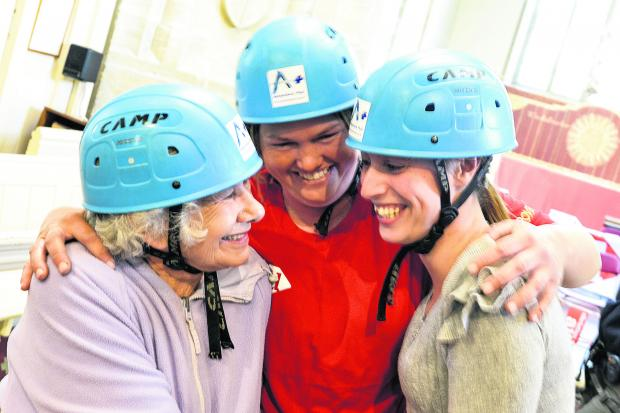 Smiles all round after Helen Hopkins, her daughter Christina Foote and granddaughter Phillippa Collins completed their abseil