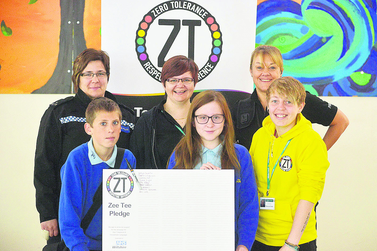 The ZT campaign to tackle homophobia in schools visits Dorcan Academy. Pictured are pupils Thomas and Kathryn with PC Sandra Higgins-Hughes, Shelly Frost, PC Rachel Barnett and Bea Potter
