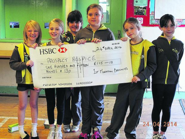Cheque mates – 1st Moredon Brownies with the results of their fundraising efforts