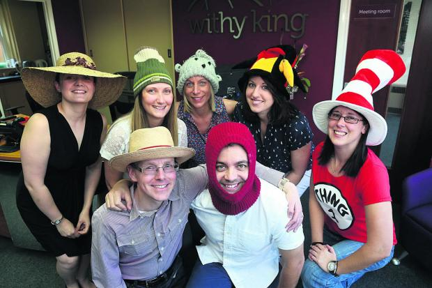 Withy King staff don their hats as part of their fundraising day to raise money for Headway in Swindon