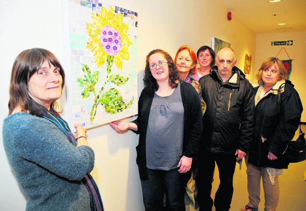 Artwork by mental health patients is unveiled at Chatsworth House to mark Mental Health Awareness Week. From left, social worker Penny Errill, Victoria Queen, Chris Dunn, Phyllida Richards, Mark Cameron and Val Denning