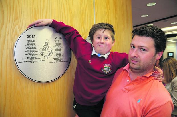 Swindon Advertiser: Morgan Sharpe, with his father Nathan, at the unveiling of this years' Pride Of Swindon plaque at the Central Library on Friday