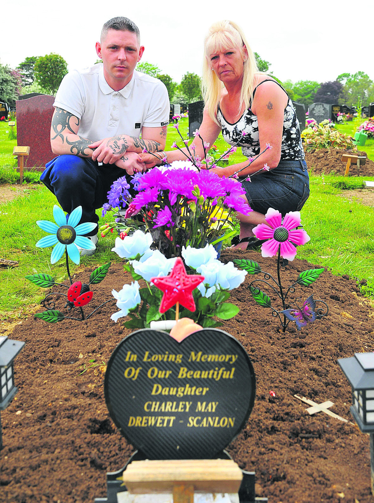 Jamie and Denice Scanlon are upset with workers at the Kingsdown crematorium who have covered their child's grave in mud