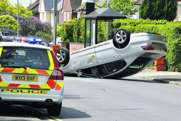A Silver VW rolled onto its roof in an accident on Okus Road, near Portland Avenue