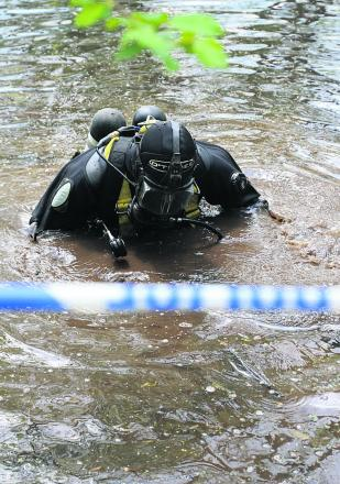 Divers searching a pond near Ramsbury where police have found property belonging to murdered Swindon woman Sian O'Callaghan. Picture: STUART HARRISON