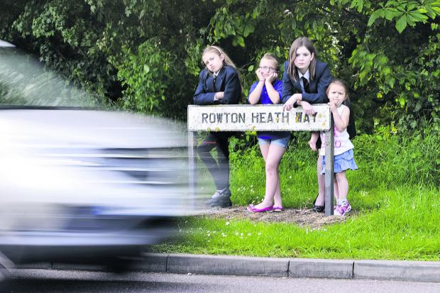 Cars are dodging the diversions around Whitehill Way, causing problems for students to safely walk to and from school. From left, local schoolchildren Mollie Aplin, Phoebe Aplin, Amber Traynor and Roxanne Aplin