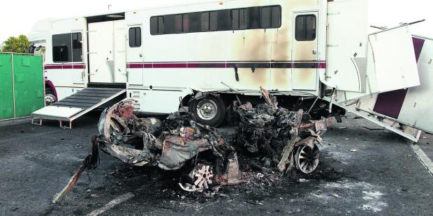 The horsebox and remains of one of the cars