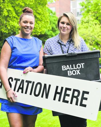 Zara Macmillan, electoral services officer, and Amy Selby, electoral services assistant, making final preparations for today's local elections