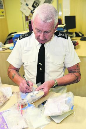 Sergeant Scott Hargreave labels some of the seized legal highs