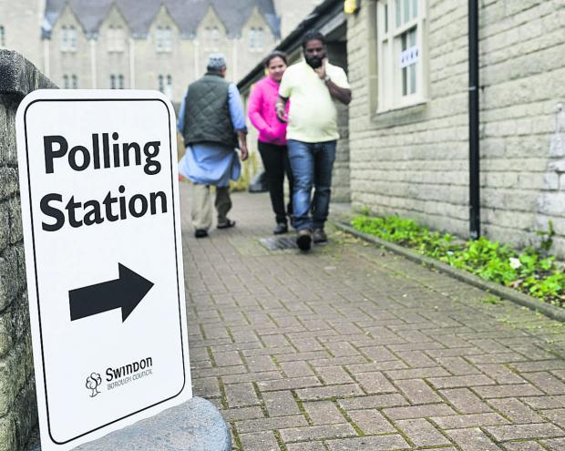 Voters entering Emlyn Square Community Centre Polling Station